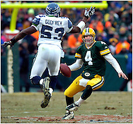 (2004)-Green Bay's Brett Favre scrambles while being chased by Seattle's Randall Godfrey during the Wild Card Playoff game.