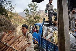 With the help of other villagers, Durga loads wood and potatoes into the truck while his eldest daughter Sumitra, 10, sits inside. He would drive overnight to Kathmandu, where they would be sold wholesale to a market vendor.<br /> <br /> Niruta and Durga were married 9 years ago, when they were just 14 and 16 years old in the Kagati village of Nepal. The 2015 earthquakes devastated Nepal and left girls and women in an increasingly vulnerable position, leading experts to believe child marriage rates will increase over the coming years.