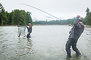 Pat Bogdan celebrates as David Page breaks the net handle on a large June chinook from BC's Dean River.