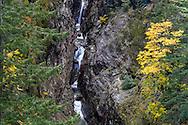 Gorge Creek Falls and fall foliage in North Cascades National Park, Washington State, USA