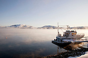 Mist drifts across a lake at Jarfjord, in the extreme cold near Kirkeness, Finnmark region, northern Norway