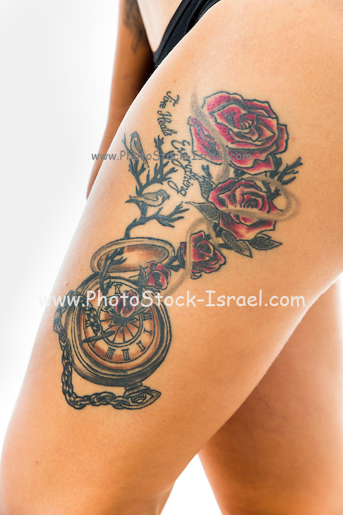 Beautiful young woman with a large tattoo on her leg close-up