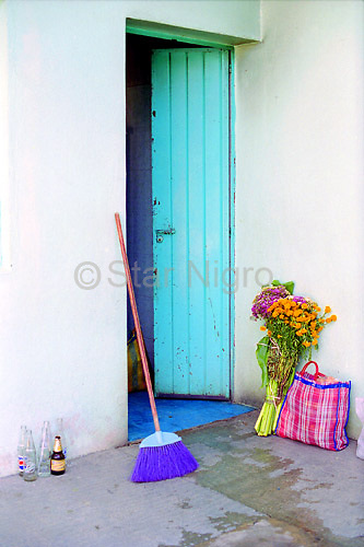 Open Door in Oaxaca,Mexico in preparation for day of the dead celebration. No photoshop was necessary for this naturally colorful scene.<br /> <br /> photo by Star Nigro<br /> <br /> ©2021 All artwork is the property of STAR NIGRO.  Reproduction is strictly prohibited.