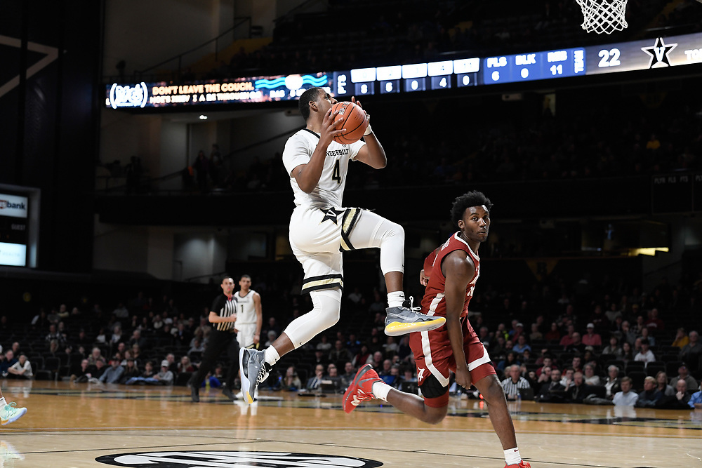 Vanderbilt Commodores guard Jordan Wright (4) scores a basket during an SEC Conference NCAA basketball game between the University of Alabama Crimson Tide and the University of Vanderbilt Commodores at Memorial Gymnasium in Nashville, TN