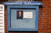 British Prime Minister, John Majors portrait is behind glass on a Conservative Associations noticeboard on 1st April 1992, in the seaside town of Frinton, Essex, England. Major went on to win the election in April that year and was the fourth consecutive victory for the Conservative Party although it was its last outright win until 2015 after Labours 1997 win for Tony Blair.