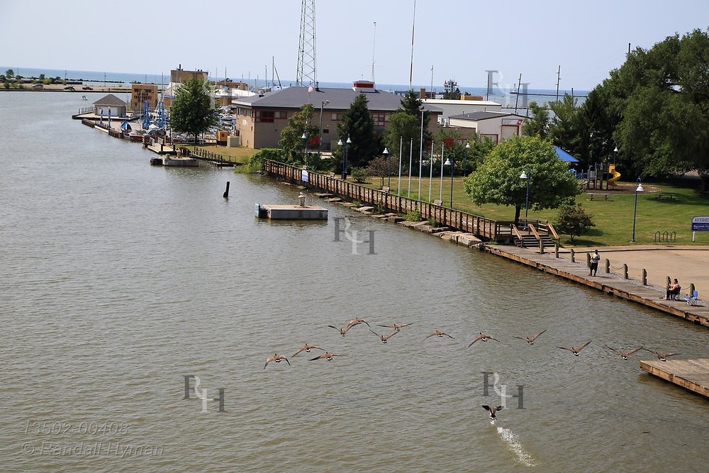 Yacht marina and waste treatment plant sit at harbor mouth on Lake Erie; Lorain, OH.