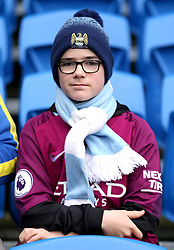A Manchester City fan in the stands before the match begins