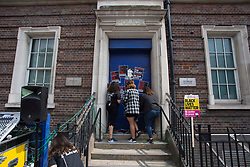 © Licensed to London News Pictures. 08/08/2020. London, UK. Black Lives Matter protestors put posters on the entrance of Tottenham Police Station in north London. Photo credit: Marcin Nowak/LNP