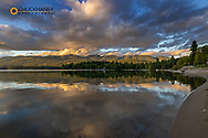 Firey sunset clouds over Whitefish Lake in Whitefish, Montana, USA