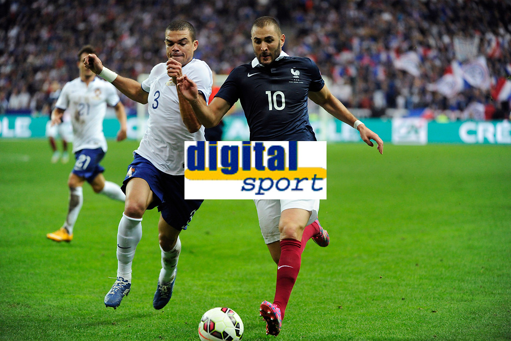 Defender Pepe of Portugal and forward Karim Benzema of France in action during the International friendly game 2014 football match between France and Portugal on October 11, 2014 at Stade de France in Saint Denis, France. Photo Jean Marie Hervio / Regamedia / DPPI