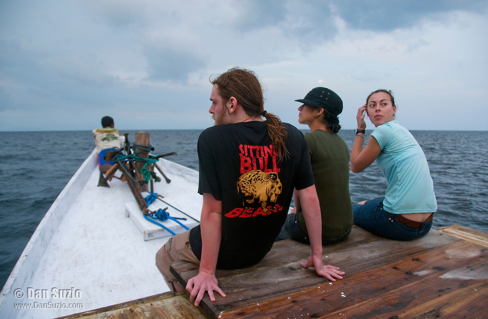 American herpetology students Scott Heacox, Marianna Tucci, and Caitlin Sanchez (l to r) sit on the deck of a boat crossing the Wetar Strait from Dili to Atauro Island, Timor-Leste (East Timor)