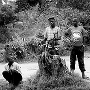 A Hutu rebel from FDLR (Forces Démocratiques de Libération du Rwanda) guards their base in a village in Rutshuru Territory in 2008. Although many victims pointed to the Rwandan rebels as prime offenders, the spokesperson of their political group denied any accusations.
