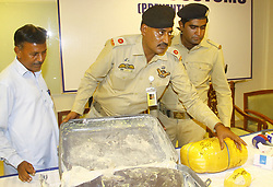 June 9, 2017 - Pakistan - KARACHI, PAKISTAN, JUN 09: Custom officer Mumtaz showing apprehended drug recovered .from a passenger at Muhammad Ali Jinnah Airport, to media persons during a press conference on Friday, June 09, 2017. (Credit Image: © PPI via ZUMA Wire)