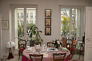 """March 11, 2015, Paris, France.  The Paris' apartment where Georges Wolinski (1934 –2015) and  Maryse Wolinski (1943, Algiers) used to live. Two month after the death of Georges Wolinski, the apartment is full of souvenirs and notes, attesting a half-century-long love relation. In 2016 Maryse Wolinski published the book """"Chérie, je vais à Charlie"""" about her husband and the attack on Charlie Hebdo. The cartoonist Georges Wolinski was 80 years old when he was murdered by the French jihadists Chérif en Saïd Kouachi, he was one of the 12 victims of the massacre in the Charlie Hebdo offices on January 7, 2015 in Paris. Charlie Hebdo published caricatures of Mohammed, considered blasphemous by some Muslims. During his life, Georges Wolinski defended freedom, secularism and humour and was one of the major political cartoonists in France. The couple was married and had lived for 47 years together. Photo: Steven Wassenaar."""
