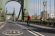After being closed indefinitely to all traffic due to structural faults, pedestrians walk across Hammersmith Bridge, on 11th April 2019, in west London, England. Safety checks revealed critical faults and Hammersmith and Fulham Council has said its ben left with no choice but to shut the bridge until refurbishment costs could be met. The government has said that between 2015 and 2021 its is providing £11bn of support to the 132-year-old bridge.