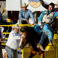 Bareback rider Luke Creasy holds on for an 83 point ride in the PRCA July 4th Rodeo at the Dean Jackson Arena in Window Rock Tuesday.