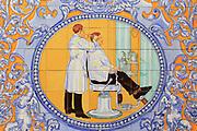 Ceramic tile picture of barber in Madrid city centre, Spain