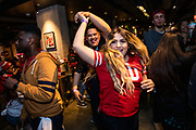 SAN FRANCISCO, CA - FEBRUARY 02: Michelle Mancilla (C) and Jesus Sosa of Sacramento, California dance during a Super Bowl LIV watch party at SPIN San Francisco on February 2, 2020 in San Francisco, California. The San Francisco 49ers face the Kansas City Chiefs in Super Bowl LIV for their seventh appearance at the NFL championship, and a potential sixth Super Bowl victory to tie the New England Patriots and Pittsburgh Steelers for the most wins in NFL history. (Photo by Philip Pacheco/Getty Images)