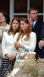 PRINCESS EUGENIE, PRINCESS BEATRICE and their father the DUKE OF YORK at the Cartier International Polo on 25th July 2004.