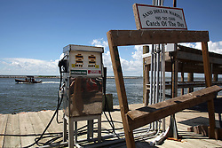 21 August 2010. Grand Isle, south Louisiana. <br /> Fishing grounds reopen yet the normally packed marina at Grand Isle remains deserted, ironically with the only catch of the day being a gas pump. BP has leased all the slips, the local motel and every available parking space making this the jump off point for crews assisting in the oil clean up operation. Recreational fishermen must travel 7 miles north to buy bait.<br /> Photo credit; Charlie Varley/varleypix.com