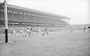 GAA All Ireland Minor football final Derry v. Kerry 26th September 1965 Croke Park...T. Quinn Derry back clears the ball from his own goalmouth as kerry forwrads move in ..26.9.1965  26th September 1965
