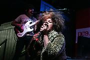 Dallas, Texas 11/10/12<br /> <br /> Atomic Tanlines frontwoman Ally Play-Nice hugs the mic stand during her band's performance at the Dallas Observer Music Awards in Deep Ellum. <br /> <br /> Credit: Mikel Galicia