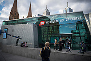 A pedestrian walks past the Melbourne Visitor Centre, located at Federation Square in the center of Melbourne, Australia