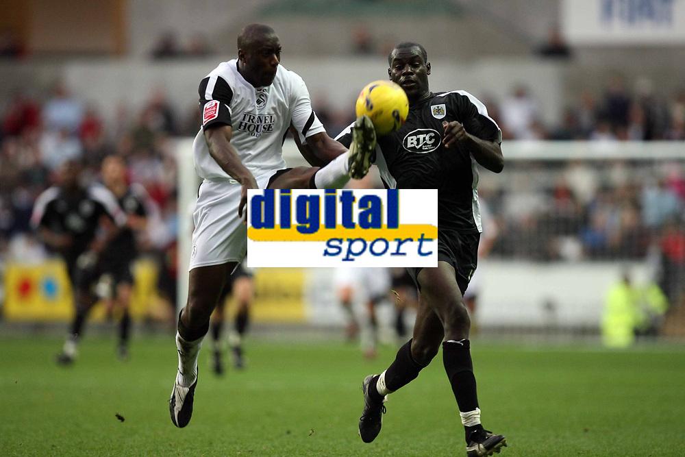 Photo: Rich Eaton.<br /> <br /> Swansea City v Bristol City. Coca Cola League 1. 26/11/2006. Kevin Austin left of Swansea gets to the ball ahead of Bristols Enoch Showunmi
