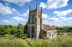 St. Giles Church in Imber village on Salisbury Plain, Wiltshire, where residents were evicted in 1943 to provide an exercise area for US troops preparing to invade Europe. Roads through the MoD controlled village are now open and will close again on Monday August 22.