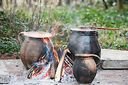 Cooking bableves (traditional bean stew) in clay pots. Busó carnival, Mohács, Hungary © Rudolf Abraham