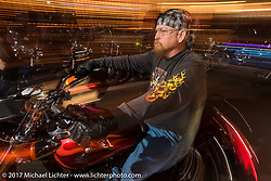 Riding main Street at the end of the first day of Daytona Beach Bike Week. FL. USA. Saturday March 11, 2017. Photography ©2017 Michael Lichter.