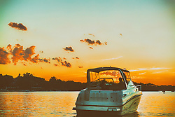 Boating into the setting sun along Lake Minnetonka - Minnesota Living