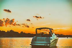 Boating into the setting sun along Lake Minnetonka - Minnesota Living