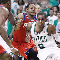 26 May 2012: Boston Celtics point guard Rajon Rondo (9) drives past Philadelphia Sixers small forward Andre Iguodala (9) on a screen set by Boston Celtics power forward Kevin Garnett (5) during the Boston Celtics 85-75 victory over the Philadelphia Sixer, in Game 7 of the Eastern Conference semifinals playoff series, at the TD Banknorth Garden, Boston, Massachusetts, USA.