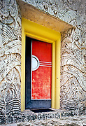 """An Art Deco door treatment on an historic private home in Miami Beach's Mid-Beach district -- This is the acclaimed General Electric Model Home  by architect Robert Law Weed , built in 1935 and based on an earlier home of the future that he designed as part of GE's """"Century of Progress"""" exhibition at the 1933 World's Fair in Chicago. This photo is from the 1990s."""