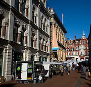 Market stalls and town centre buildings, Lloyds Avenue, Ipswich, Suffolk, England