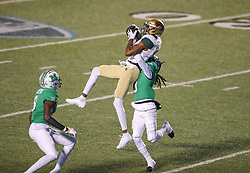 Dec 18, 2020; Huntington, West Virginia, USA; UAB Blazers wide receiver Myron Mitchell (5) catches a pass over Marshall Thundering Herd defensive back Steven Gilmore (3) during the first quarter at Joan C. Edwards Stadium. Mandatory Credit: Ben Queen-USA TODAY Sports