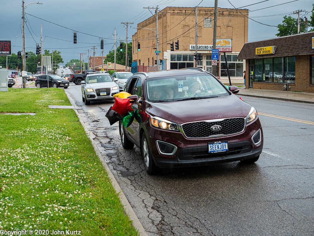 19 JUNE 2020 - DES MOINES, IOWA: People drive down 30th Street in Des Moines during a Black Lives Matter caravan at the State Fairgrounds during Juneteenth celebrations. The caravan drove through the Des Moines metro area. The caravan was called Ride With Us, a Driving March. Hundreds of motorists participated in the rush hour event.       PHOTO BY JACK KURTZ