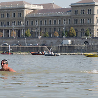 Participants of the Budapest Urban Games swim across River Danube in downtown Budapest, Hungary on Aug. 29, 2020. ATTILA VOLGYI