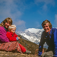 Meredith, Ben and Gordon Wiltsie relax in front of Mount Everest while trekking in the Khumbu region of Nepal.
