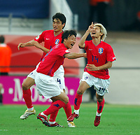 World Cup 2006 Germany Frankfurt 13/06/2006<br />Korea v Togo <br />Chun Soo Lee  (Korea)  celebrates equaliser with Young Pyo Lee<br />Photo Roger Parker Fotosports International