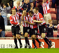Photo. Jed Wee.<br /> Sunderland v Ipswich Town, Nationwide League Division One, Stadium of Light, Sunderland. 30/09/2003.<br /> Sunderland celebrate with goalscorer John Oster (12).