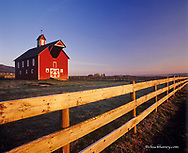 Red barn with fence near Joseph, Oregon, USA
