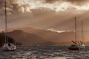 View of Hallin Fell, lit by the autumn sun, with yachts on Ullswater in the foreground.