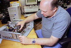 Man with disability repairing computer,