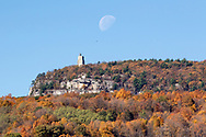 The waning gibbous moom sets behind Skytop Tower on the Shawangunk Ridge on Oct. 18, 2019. Skytop Tower is located in the Mohonk Presverve in Ulster County, N.Y.