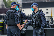 Armed police were disarmed and called for extra-support to handle the situation with Extinction Rebellion activists who glued themselves by the main entrance of the Houses of Parliament, outside Westminster Palace are being taken by the Police, Thursday, Sept 3, 2020. Environmental non-violent activists group Extinction Rebellion enters its 3rd day of continuous ten days to disrupt political institutions throughout peaceful actions swarming central London into a standoff, demanding that central government obeys and delivers Climate Emergency bill.