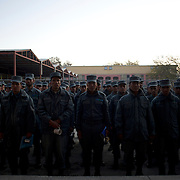 Afghan National Police (ANP) cadets line up waiting for their turn to enter the canteen for breakfast at the Afghan Nacional Police Academy in Kabul.