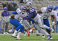 Defensive end Tyrone Taleni #50 of the Kansas State Wildcats sacks quarterback Jalon Daniels #17 of the Kansas Jayhawks, during the second half at Bill Snyder Family Football Stadium on October 24, 2020 in Manhattan, Kansas.