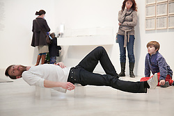 "© London News Pictures. 22/02/2013. Margate, Kent. Artist Matthias Sperling performs his work ""To Hand"" at the Turner Contemporary in Margate, Kent. Matthias Sperling is part of the Siobhan Davies Dance group and whose performance involves balancing on everyday objects whilst moving around the gallery containing Carl Andres ""Mass and Matter exhibition also on at the gallery. Photo credit should read Manu Palomeque/LNP."